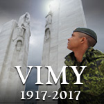 Soldier looking at the Vimy memorial
