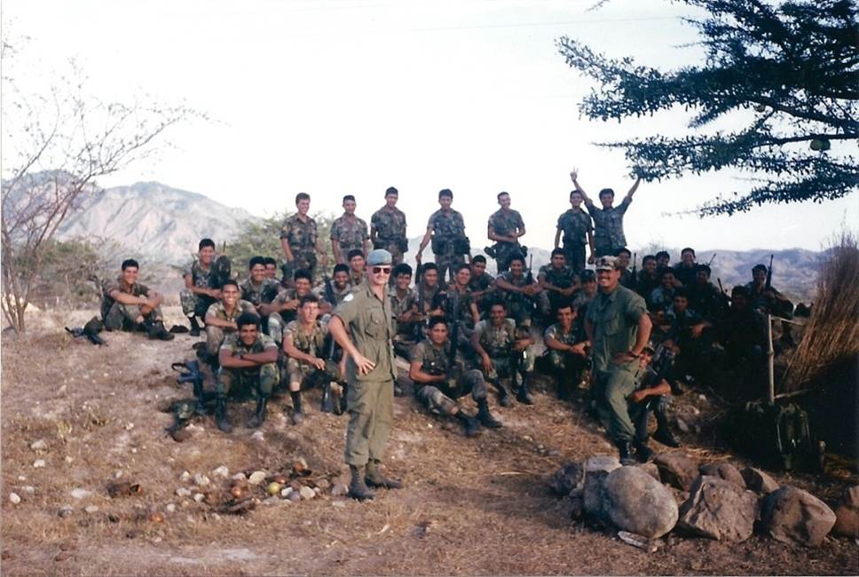 Captain Rob Roy MacKenzie after transferring to the Regular Force in 1989, with members of the El Salvadorian Army. He served on two missions in Central America as a United Nations Military Observer: first in Guatemala, and then in El Salvador. Photo provided by: BGen Rob Roy MacKenzie.