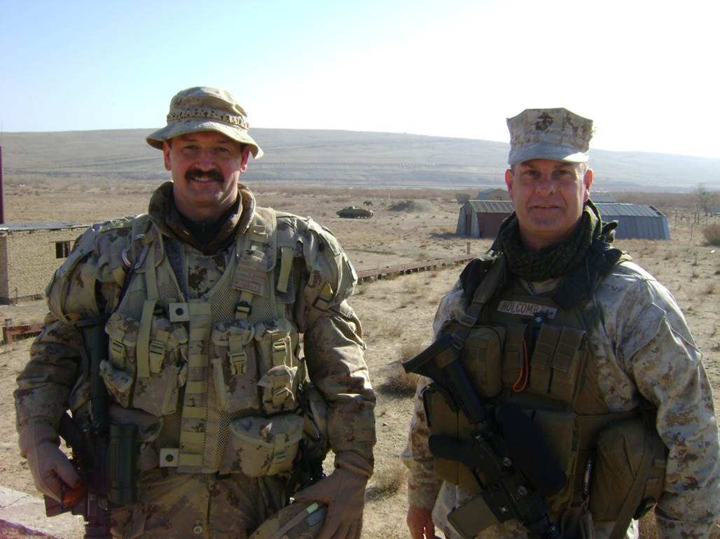 Colonel Rob Roy MacKenzie is shown here with Colonel Holcombe of the United States Marine Corps near the Afghanistan-Turkmenistan border during his second deployment to Afghanistan, where he served until the end of 2011 with the NATO Training Mission – Afghanistan as the Senior Advisor to the Afghan Border Police, a specialized police organization with 23,000 members. Photo provided by: BGen Rob Roy MacKenzie.