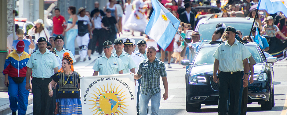 Slide - CAF leads Latin American Festival parade