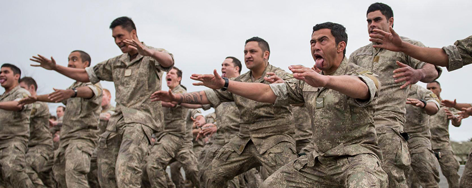 Slide - Soldiers in the Powhiri ceremony, a traditional Maori welcome