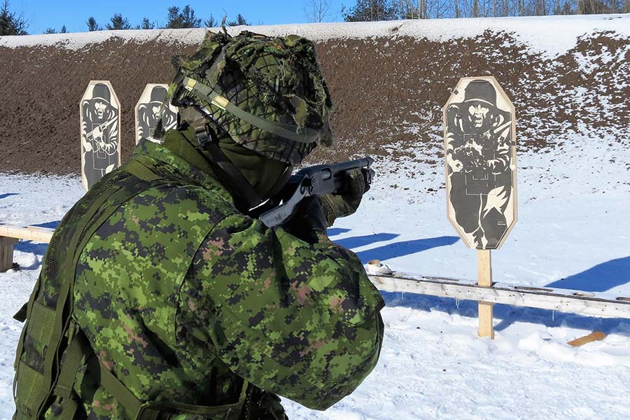 Warrant Officer Ron Wen fires a shotgun during training at CFB Borden. Photo: Sgt Peter Moon, 3 CRPG