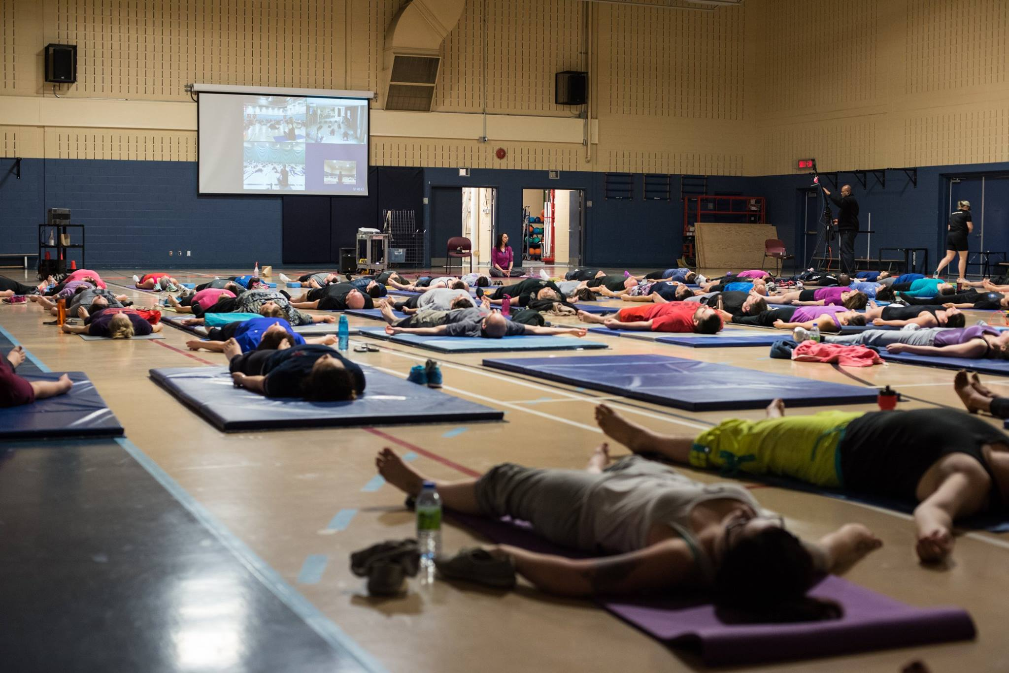 Relaxation period at the end of the yoga session. Members of the Defence Team of the 2nd Canadian Division and Joint Task Force (East) participate in Exercise YOGA 2017 (# ExYOGA2017), a yoga session live-streamed from several locations for all – women and men, both civilian and military –  to highlight International Women's Day at Canadian Forces Base/ Area Support Unit Montreal on March 8, 2017. Photo: Corporal Djalma Vuong-De Ramos, 2nd Canadian Division/Joint Task Force (East) ©2017 DND/MDN Canada
