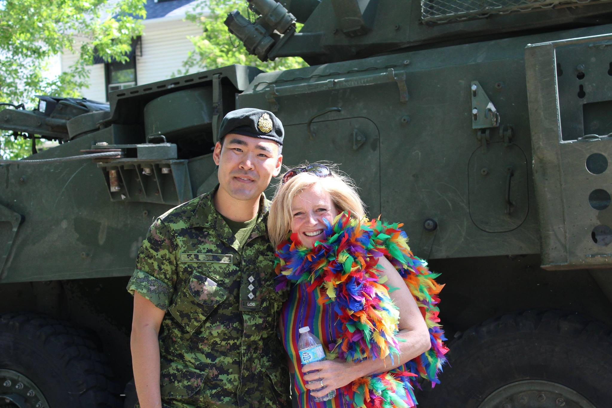 "Captain Matthew Hou with Premier Rachel Notley at the 2013 Pride Parade, which included the first-ever entry from the Canadian Armed Forces (CAF). ""It was great to see the Premier of Alberta at the parade supporting the CAF and the LGBTQ community,"" said Capt Hou, who was the organizer of the CAF's participation.