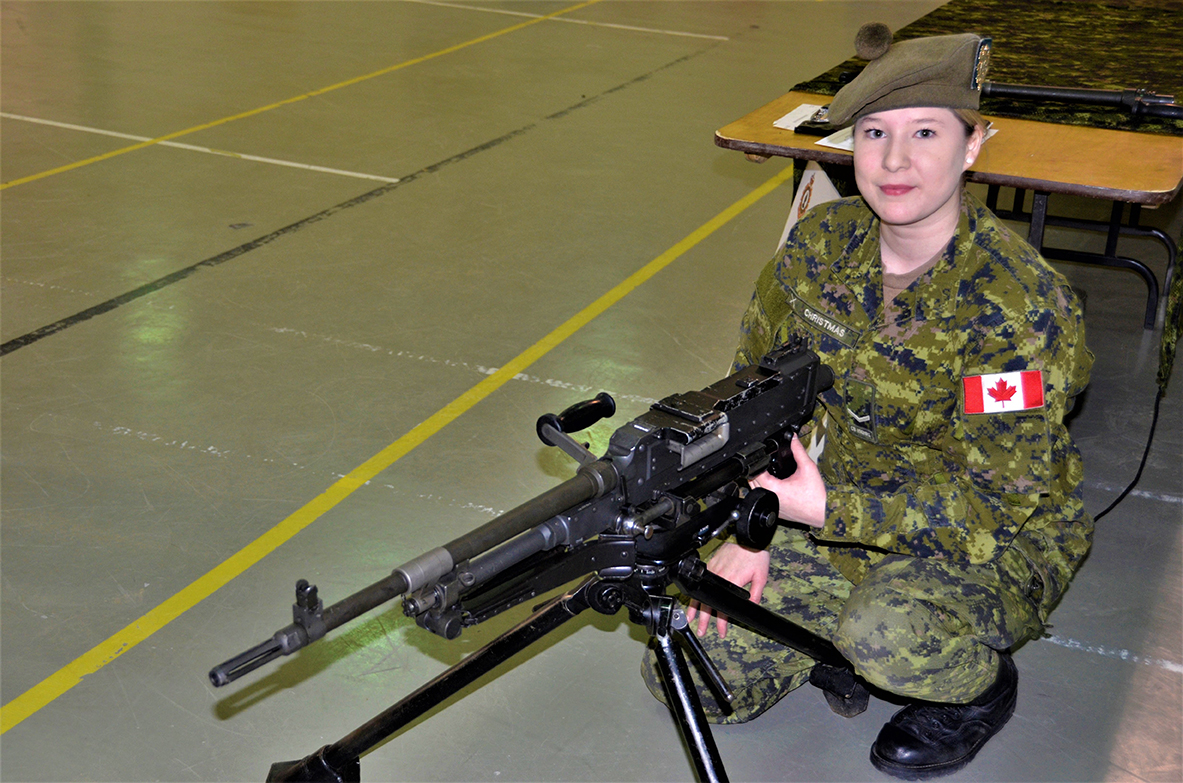 Private Kendra Christmas demonstrates the use of a C6 machine gun