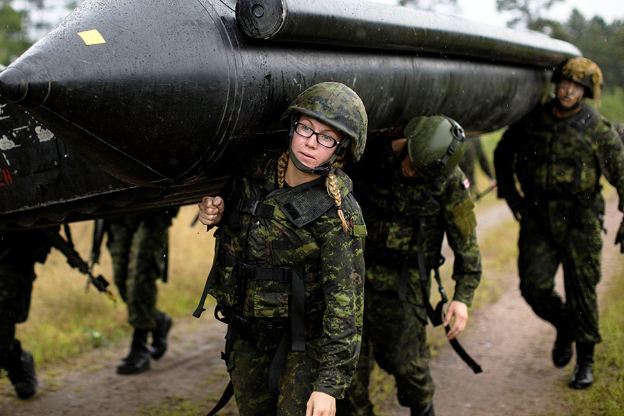 Bombardier Marie-Eve Cotton, from the 30th Field Artillery Regiment, helps carry an assault boat during Exercise STALWART GUARDIAN on August 20, 2015 at Canadian Forces Base Petawawa, Ontario. New assault boats are coming to the Canadian Army and in greater numbers than previously.