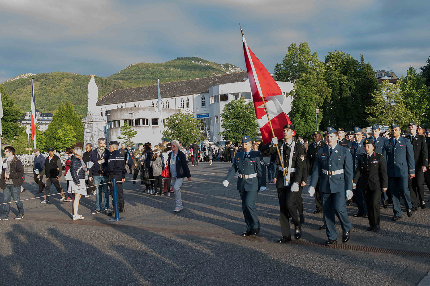 "The Canadian Armed Forces Contingent parades in the streets of Lourdes, France towards the Monuments aux Morts war memorial during the International Military Pilgrimage on May 20, 2017. Photo: Sergeant Dwayne ""George"" Janes, Army Public Affairs. ©2017 DND/MDN Canada."