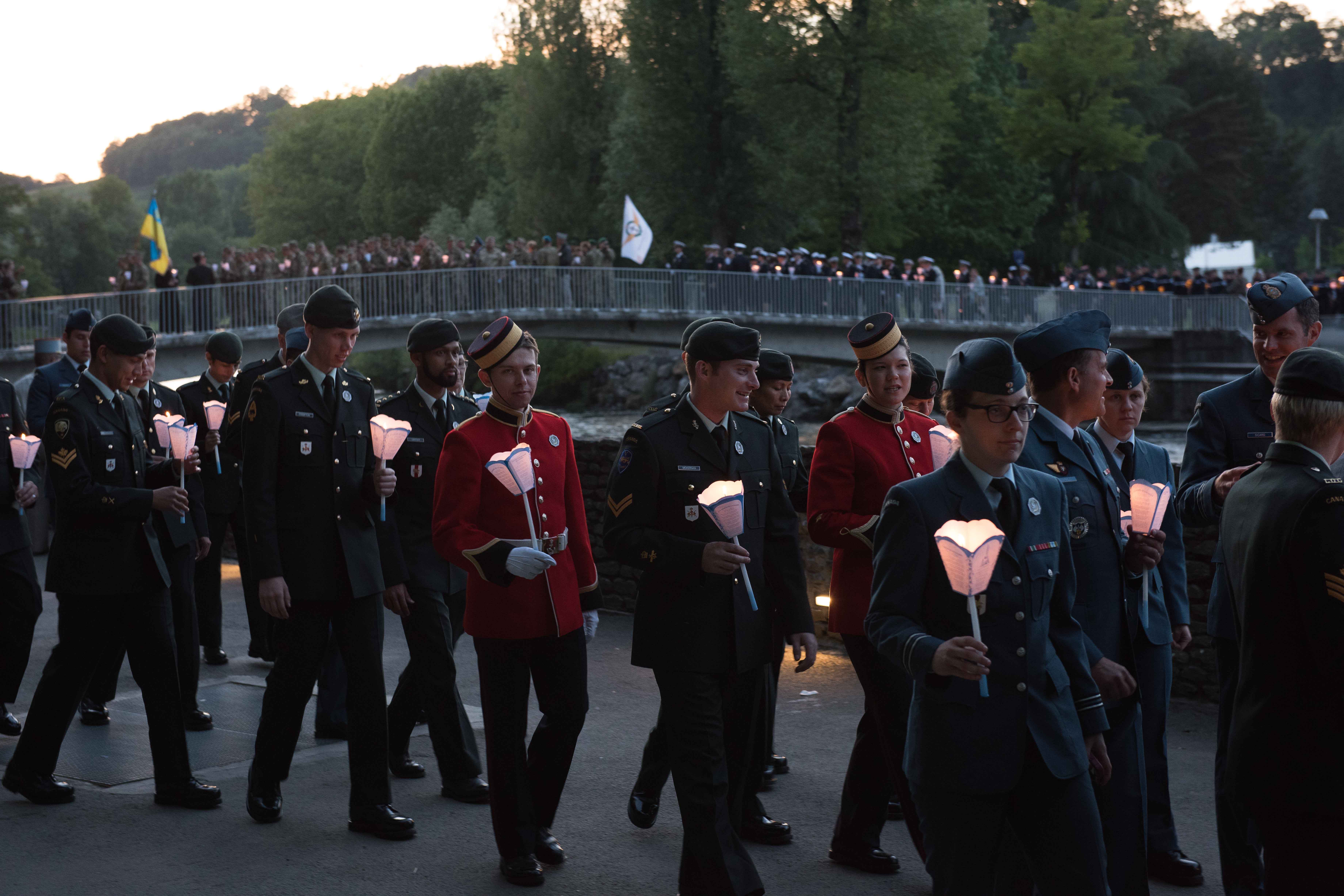 "The Canadian Armed Forces Contingent participates in the candlelight procession as the sun sets over Lourdes, France during the International Military Pilgrimage on May 20, 2017. Photo: Sergeant Dwayne ""George"" Janes, Army Public Affairs. ©2017 DND/MDN Canada."