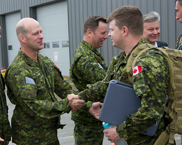 Colonel William Fletcher, Commander of 1 CMBG, shakes the hand of a soldier to be deployed