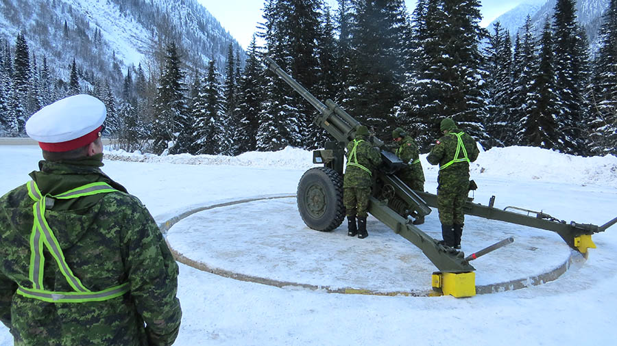 An Assistant Instructor-in-Gunnery oversees a C3 105mm Howitzer Detachment