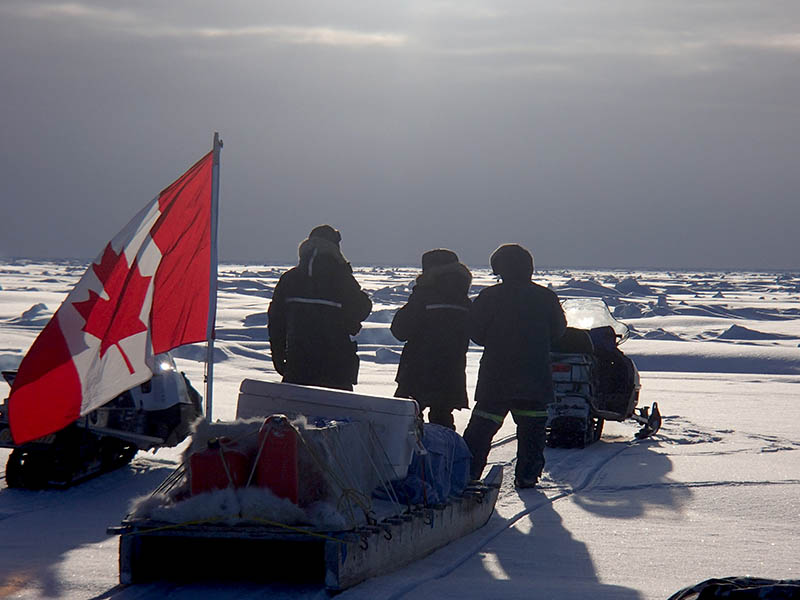 Mike Dempsey of Fisheries and Oceans Canada is pictured with Canadian Rangers Corporal Tom Epakohak and Sergeant Jimmy Evalik near Cambridge Bay on February 18, 2017. Canadian Rangers in the Northwest Territories and Nunavut guided Fisheries and Oceans researchers on a recent research trip and are also assisting them in gathering oceanographic data.