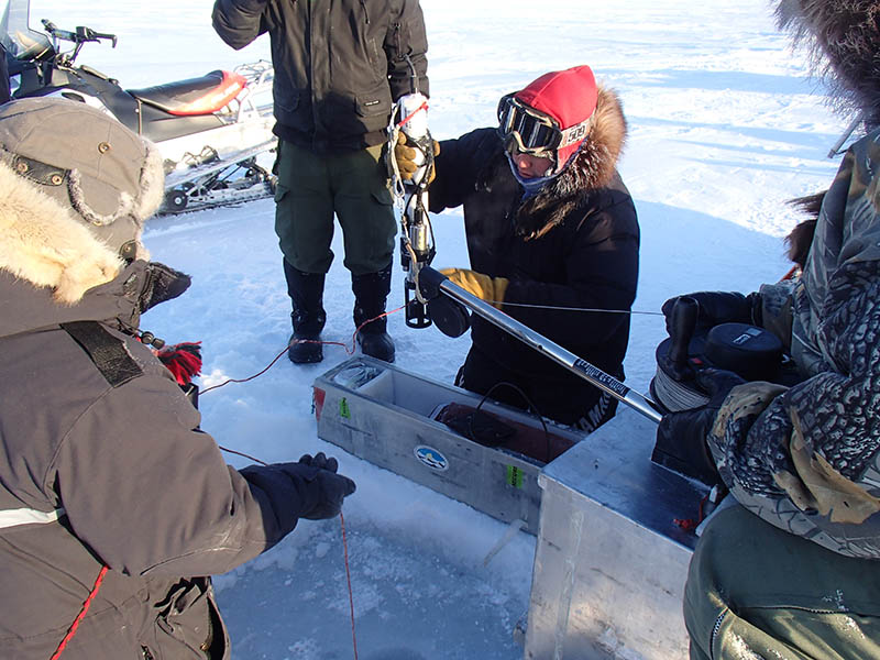 Ranger Gustin Adjun works with equipment provided by Fisheries and Oceans Canada near Kugluktuk, Nunavut on February 12, 2017. Members of 1st Canadian Ranger Patrol Group recently acted as guides for Fisheries and Oceans Canada researchers carrying out oceanographic research in the region and are also helping gather data.