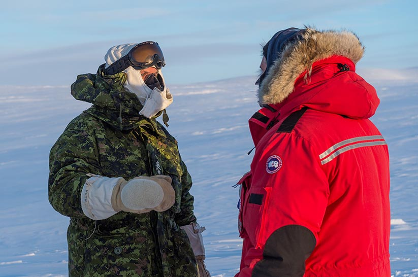Major General Hetherington, Commander of the Canadian Army Doctrine and Training Centre, (left) speaks with a member of the training team during a visit to the Arctic Training Centre at Resolute Bay, Nunavut on February 24, 2018. The Centre is jointly run by the Canadian Armed Forces and Natural Resources Canada. Photo: Master Corporal Jennifer Kusche, Canadian Forces Combat Camera. ©2018 DND/MDN Canada.