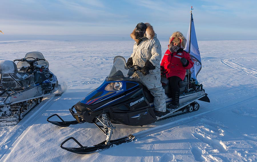 Captain Wayne LeBlanc (left), Course Commander of the Arctic Operations Advisors course, deploys a snowmobile with a Canadian Ranger (right) in Resolute Bay, Nunavut on February 24, 2018. MGen Hetherington visited the Arctic Training Centre to observe Arctic training. Photo: Master Corporal Jennifer Kusche, Canadian Forces Combat Camera. ©2018 DND/MDN Canada.