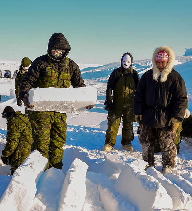 In preparation for an overnight stay at Crystal City, members of the Arctic Response Company Group cut snow blocks to be used for a snow wall during Operation NUNALIVUT, near Resolute, Nunavut on March 8th, 2018. Photo: Petty Officer Second Class Belinda Groves, Task Force Imagery Technician.