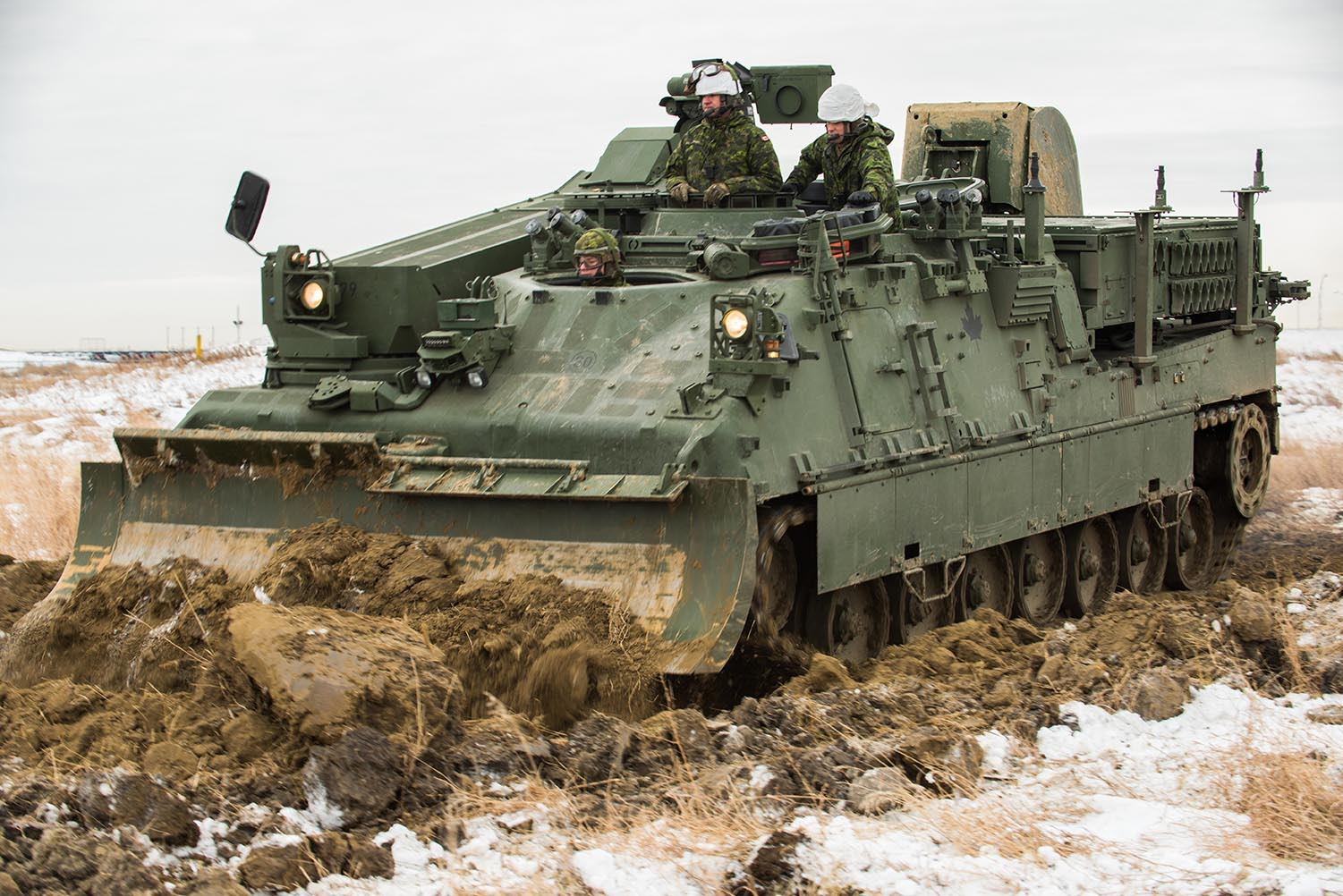 Master Corporal Joseph Facoeitti, Crew Commander, Master Corporal Kasey Davis and Corporal Zachary Brum, Driver level ground during crew training on the Leopard 2 Armoured Engineering Vehicle conducted in the training area of 3rd Canadian Division Support Base Edmonton on December 4, 2017.