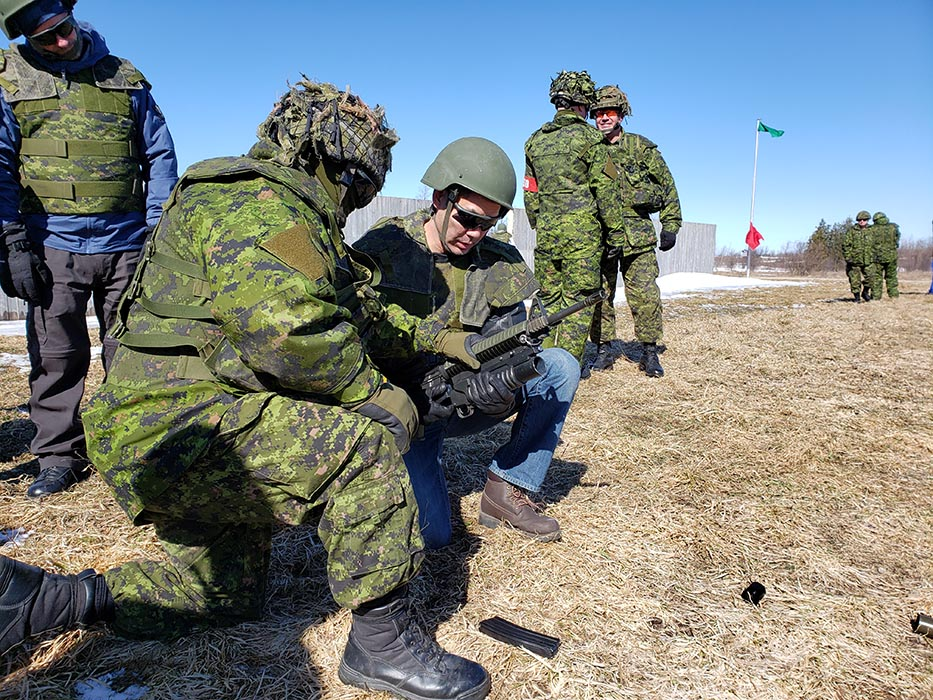 A member of the Windsor-Chatham community receives instruction on the C7A2 service rifle from a Canadian Army Reservist as part of the ExecuTrek program during Exercise SCOTTISH DEFENDER at the 4th Canadian Division Training Centre in Meaford, Ontario on March 23, 2019. Photo: Sub-Lieutenant Andrew McLaughlin, 31 Canadian Brigade Group Public Affairs. ©2019 DND/MDN Canada.
