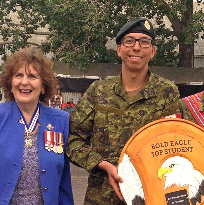 Private Jared Daschner receives the Joe Kytwayhat Top Student award from Her Honour, The Lieutenant-Governor of Alberta, Lois Mitchell upon completion of the Bold Eagle Program in 2018. Photo: Provided by Private Jared Daschner
