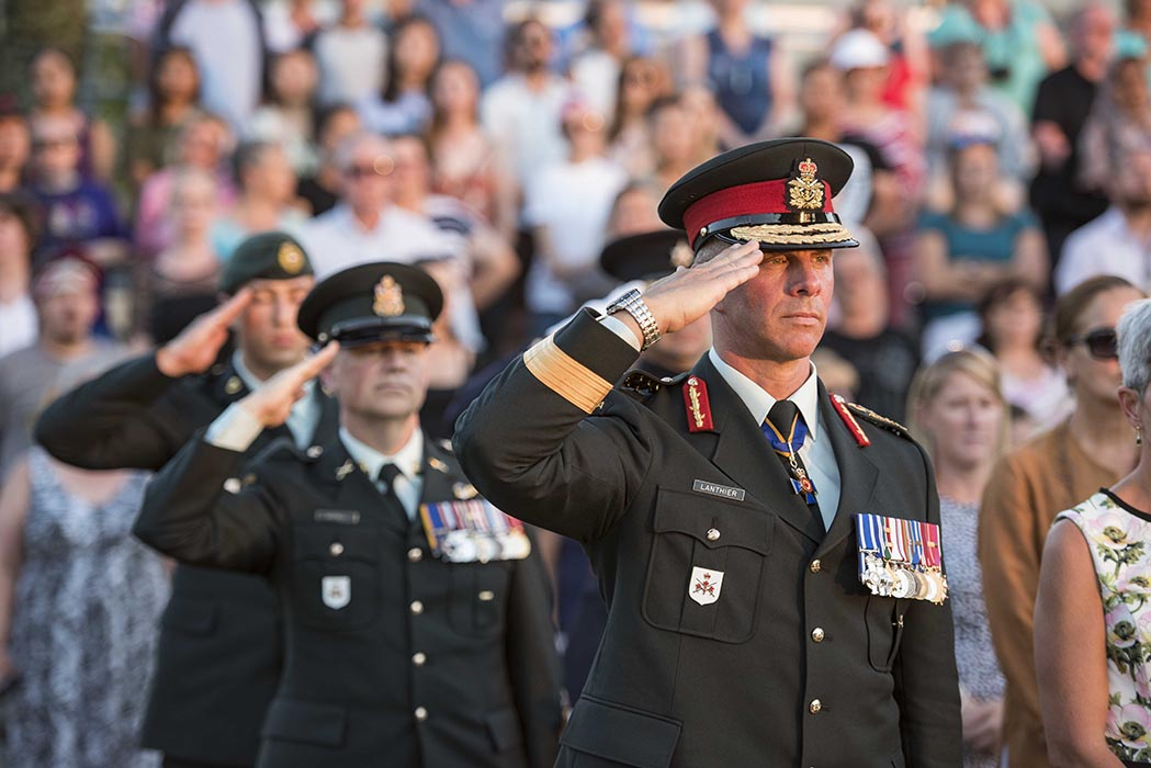 Lieutenant-General Jean-Marc Lanthier, Commander of the Canadian Army, salutes while the national anthem plays during the annual Fortissimo event on Parliament Hill in Ottawa, Ontario on July 19, 2018. Photo: Ordinary Seaman Camden Scott, Army Public Affairs. ©2018 DND/MDN Canada.