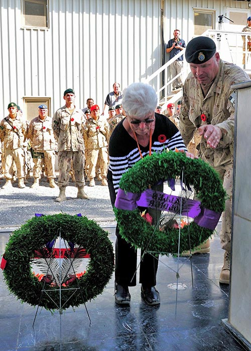 Silver Cross Mother Mable Girouard, mother of Chief Warrant Officer Robert Girouard, places a wreath in his honour on the Kandahar Cenotaph during the last Remembrance Day ceremony held there on November 11, 2011. The Cenotaph now has a permanent home at National Defence Headquarters (Carling) in Ottawa. Photo: Sergeant Lance Wade, Mission Transition Task Force Headquarters. © 2011 DND/MDN Canada.