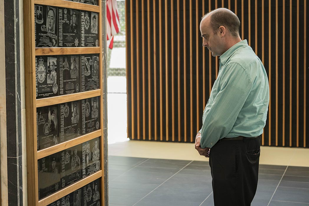 At the Afghanistan Memorial Hall in Ottawa, Ontario on June 11, 2019, a visitor looks at plaques commemorating Canadian and American military personnel who lost their lives in Afghanistan. Photo: Able Seaman Camden Scott, Army Public Affairs. ©2019 DND/MDN Canada.