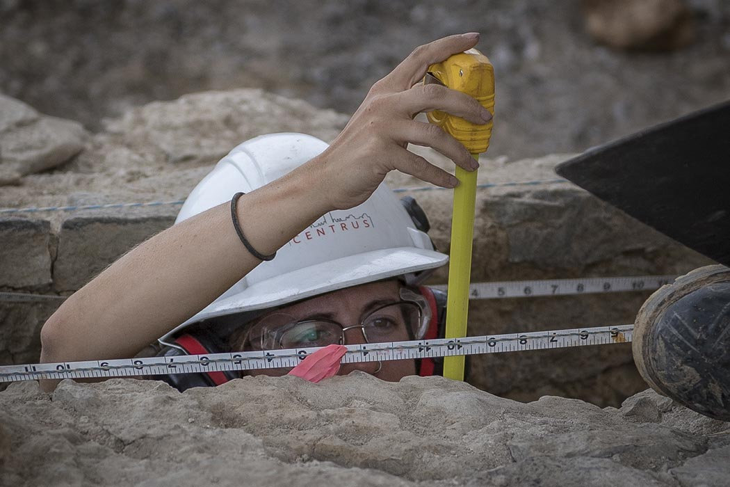 On July 30, 2019, an archeologist from the Centre Block Rehabilitation Project measures the height of one of the foundation walls found in the remains of a 19th-century guard house on Parliament Hill in Ottawa, Ontario. Photo: Able Seaman Camden Scott, Army Public Affairs. ©2019 DND/MDN Canada.