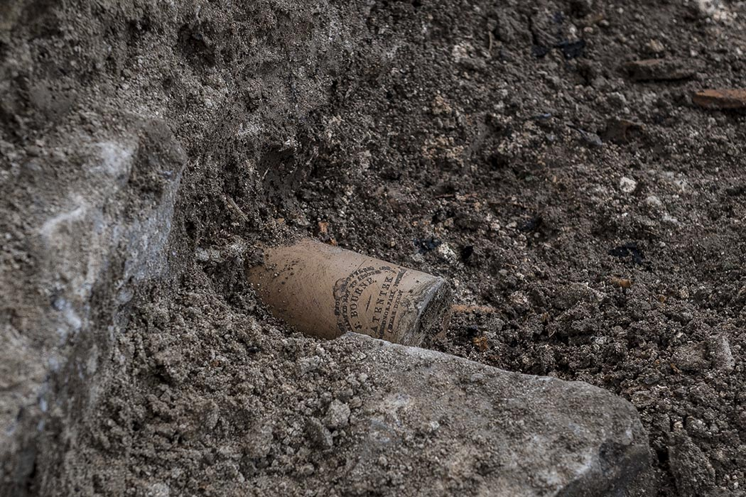 A well-preserved ceramic ink bottle used to for quill-and-ink writing is carefully excavated from the remains of a privy found in a 19th-century guard house on Parliament Hill in Ottawa, Ontario on July 30, 2019. Privies were routinely used to dispose of unwanted items. Photo: Able Seaman Camden Scott, Army Public Affairs. ©2019 DND/MDN Canada.
