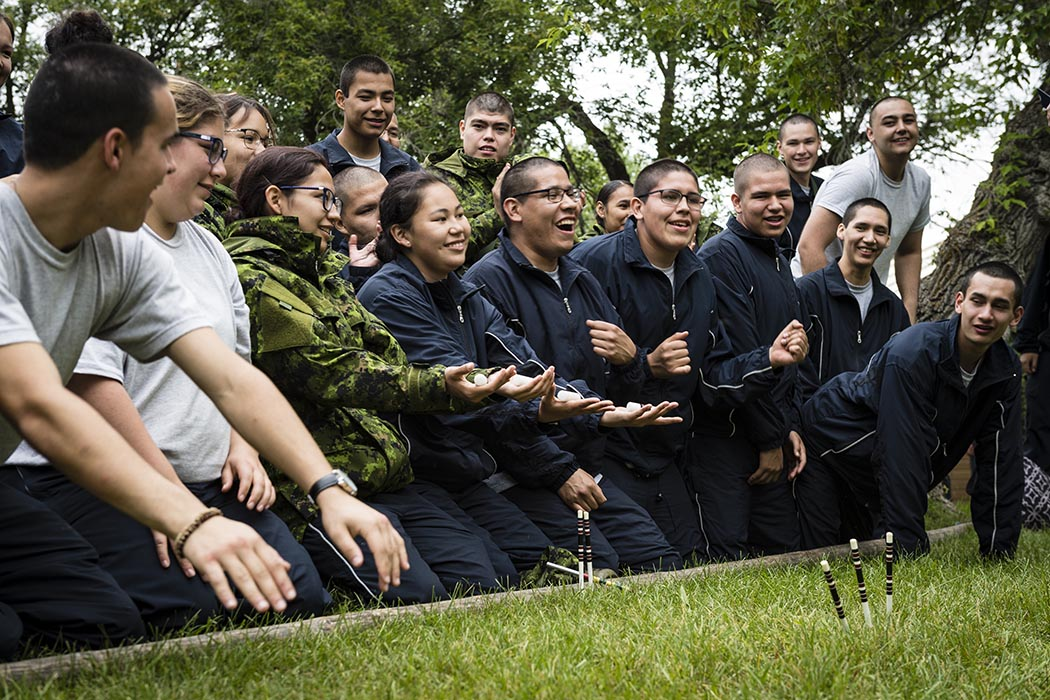 Candidates of Bold Eagle 2019 gather for traditional hand games during Culture Camp at Buffalo Park Hall of 3rd Canadian Division Support Base Wainwright on July 8, 2019. Photo: Master Corporal Jay Ekin, Canadian Forces Base Wainwright Imaging. 2019 DND/MDN Canada.