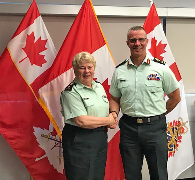 Honorary Colonel Kathleen LeGrow receives the Commander's Coin for her service as an Honorary from then-Commander Canadian Army Lieutenant-General Jean-Marc Lanthier during the National Council of Honoraries in Ottawa on July 6, 2019.