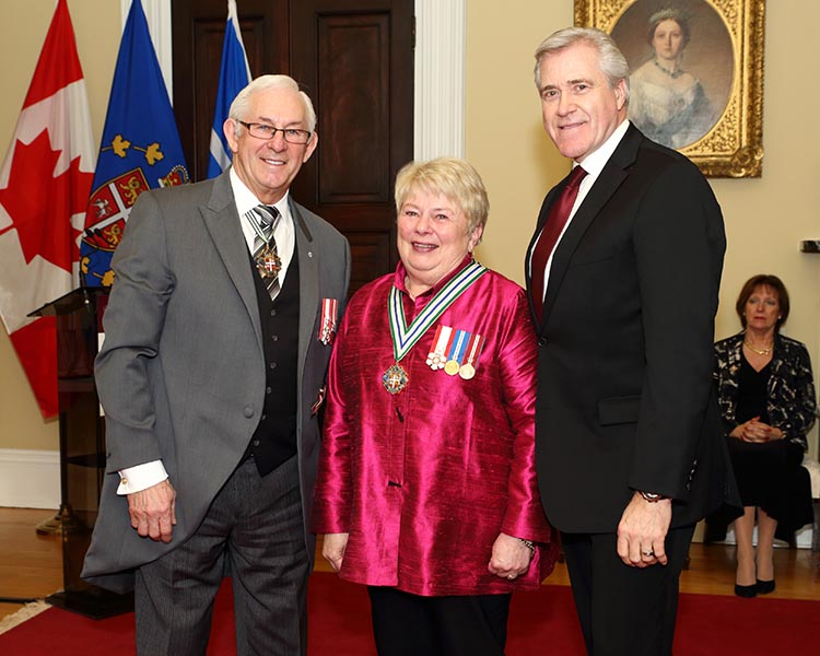 Kathleen Pratt LeGrow receives the Order of Newfoundland and Labrador in 2018 from Lieutenant Governor Frank F. Fagan (left) and Premier Dwight Ball (right). The highest honour of the province, the Order recognizes individuals who have demonstrated excellence and achievement benefiting in an outstanding manner Newfoundland and Labrador and its residents. Photo: Provided by the Government of Newfoundland and Labrador ©2018.