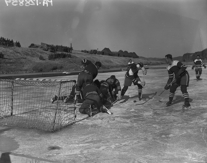 An image of the first hockey championship match between the 1st Battalion Princess Patricia's Canadian Light Infantry and 2nd Battalion Royal 22e Regiment