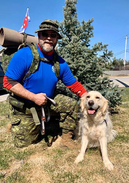 The Commanding Officer of the Cameron Highlanders of Ottawa (Duke of Edinburgh's Own) Lieutenant-Colonel Gord Scharf poses with his dog, Angus (goes by 'Haggis'). Photo provided by Lieutenant-Colonel Gord Scharf