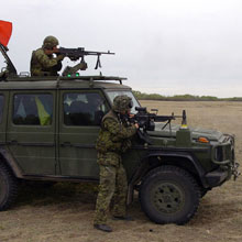 Soldiers mount their weapons on a G Wagon.