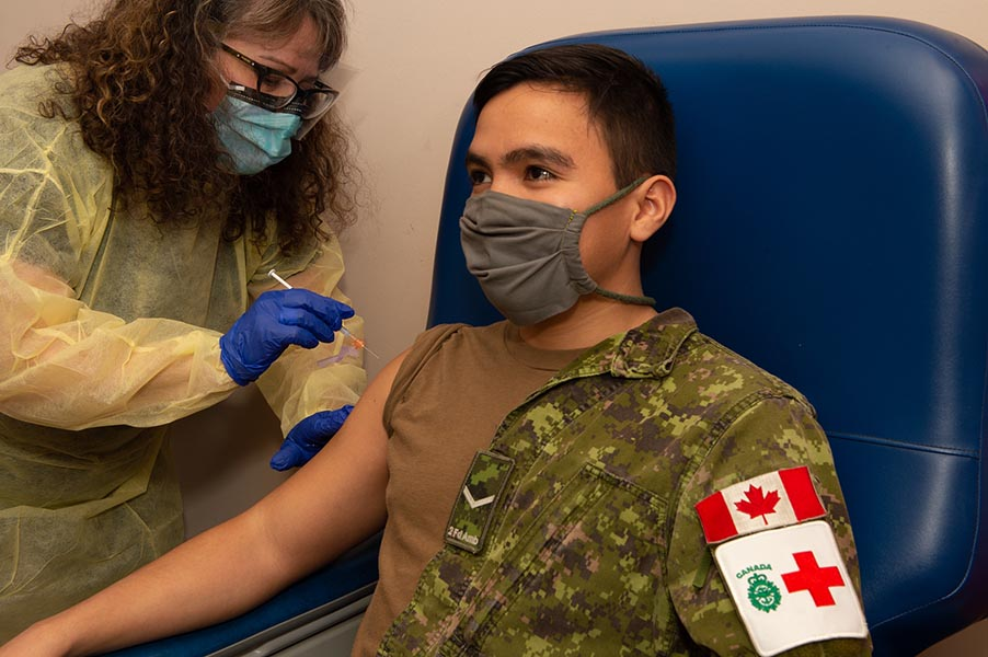 2 Field Ambulance Medical Technician, Private Luis Penagos receives his COVID-19 vaccination at Garrison Petawawa on Thursday January 7, 2021.